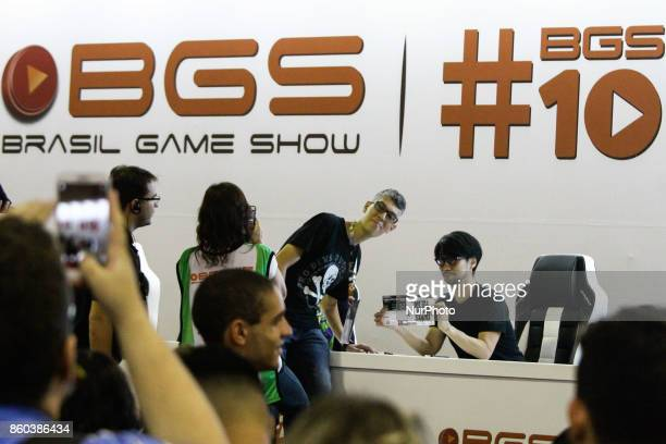 Japanese video game designer and producer Hideo Kojima attends an autograph session with fans during the 10th edition of Brazil Game Show in São...