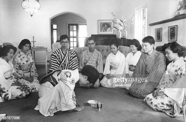 Japanese visitors who have spent August in Denver area homes entertain their American families Thursday night at a Japanese tea ceremony in the...