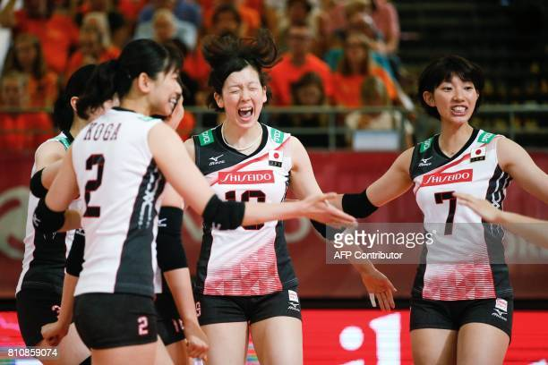 Japanese volleyball players Mari Horikawa and Yuki Ishii celebrate during their match against the Dominican Republic at the women volleyball world...
