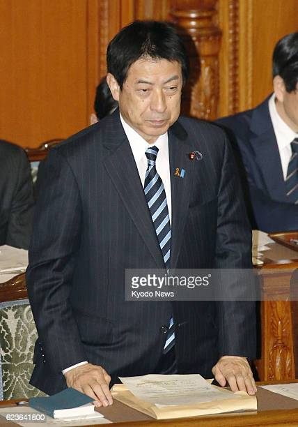 Japanese welfare minister Yasuhisa Shiozaki bows to a House of Councillors plenary session in Tokyo on Nov 16 which enacts a law to shorten the time...