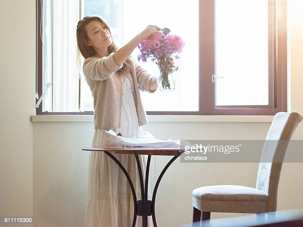 japanese Woman arranging flowers