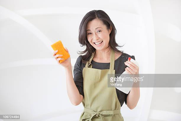 Japanese Woman Cleaning House, Holding a Sponge and Spray Bottle