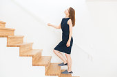Japanese woman climbing the stairs