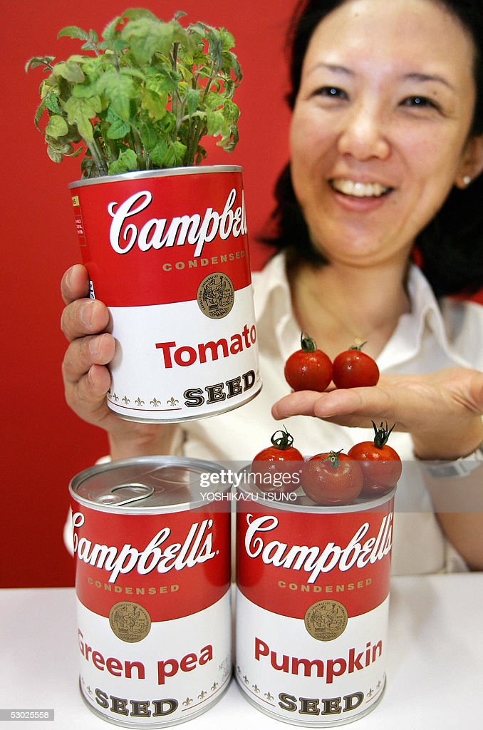 A Japanese woman displays a canned plant shaped like a Campbell's soup can 'Campbell's Seed', priced 997 yen (9.25 USD), in Tokyo 06 June 2005. Tokyo based flower venture World Flower service launched three types of canned vegetable plants, tomatoes, pumpkins and green peas, containing seads and special potting compost. AFP PHOTO / Yoshikazu TSUNO