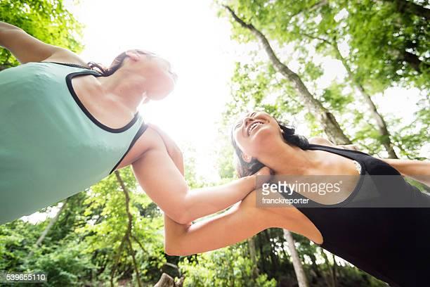 japanese woman doing yoga outdoors