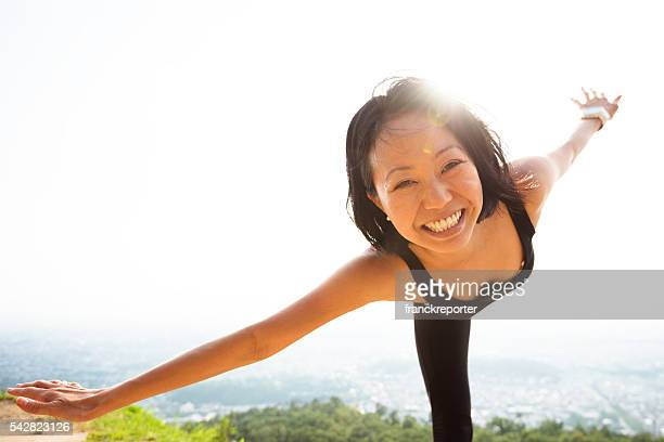 japanese woman doing yoga outdoors