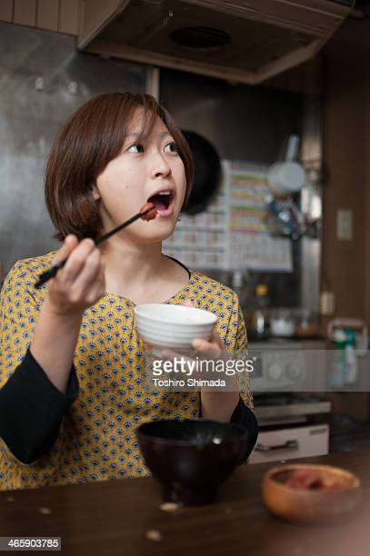 Japanese woman eating rice