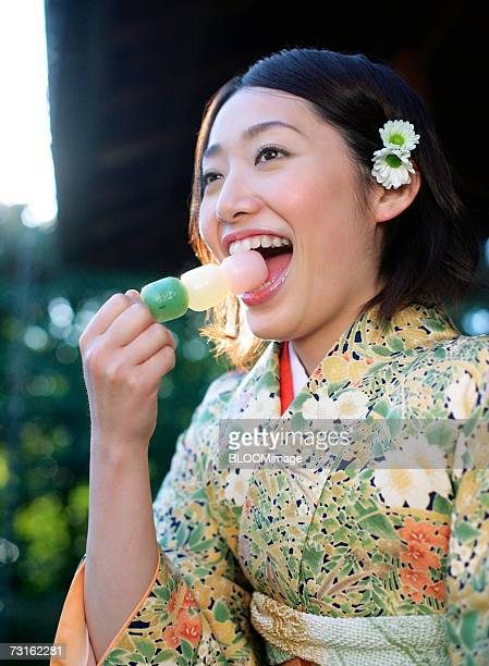 Japanese woman eating sweets