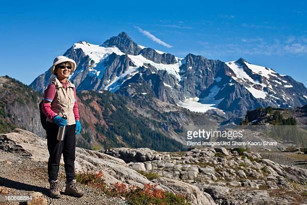 Japanese woman hiking near mountain