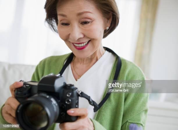 Japanese woman holding digital camera