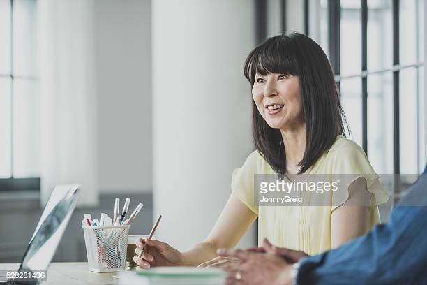 Japanese woman in business meeting candid portrait