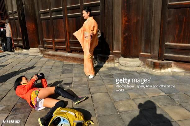 Japanese Woman in Kimono and Female Photographer at Tofuku-ji, Kyoto