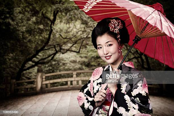 Japanese Woman in Kimono and Zen Garden