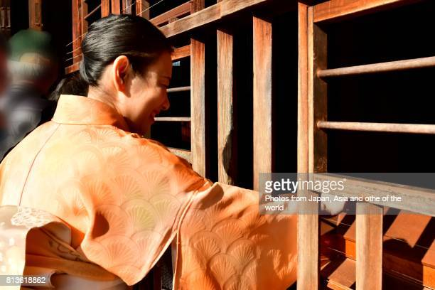 Japanese Woman in Kimono Praying at Tofuku-ji Temple, Kyoto