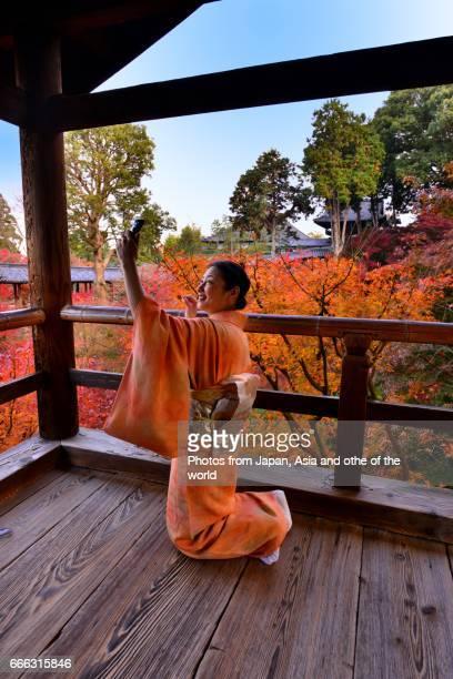 Japanese Woman in Kimono Taking Selfie at Tofuku-ji Temple, Kyoto