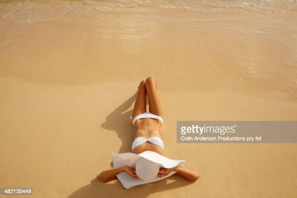 Japanese woman laying on beach