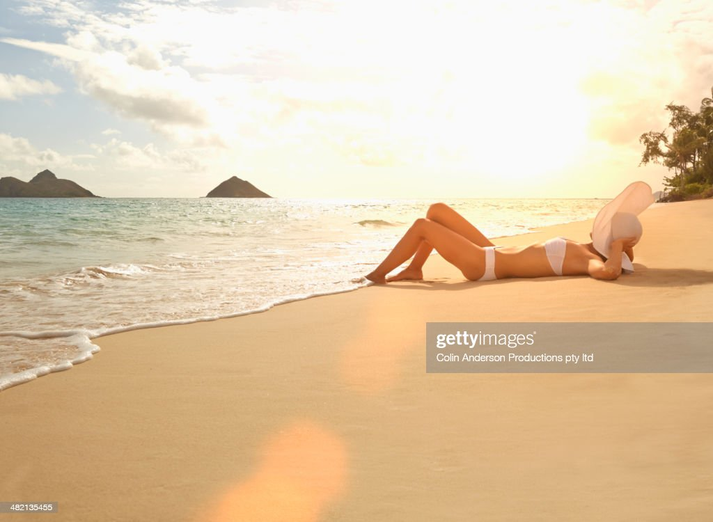 Japanese woman laying on beach