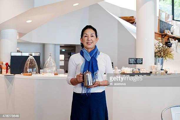 Japanese woman manager in coffee shop, Tokyo.