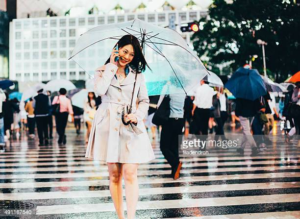 Japanese woman outside in the rain