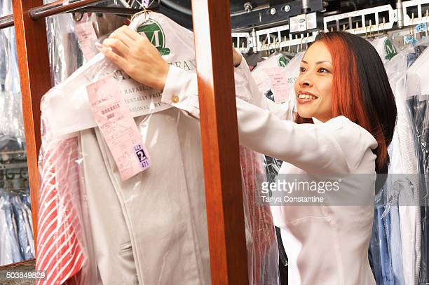 Japanese woman picking up dry cleaning