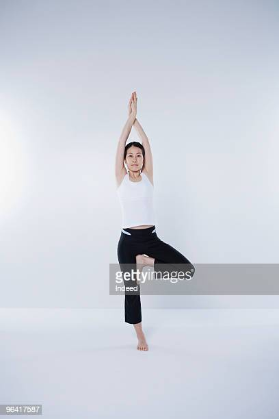 Japanese woman practicing yoga