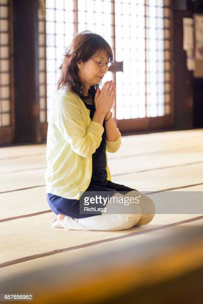 Japanese Woman Praying the Temple