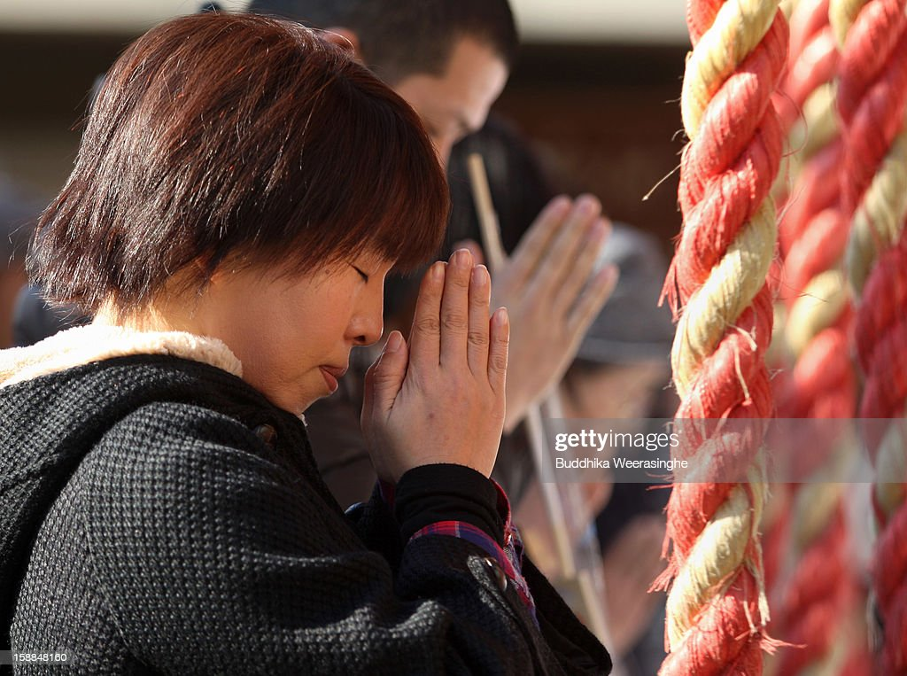 A Japanese woman prays to mark New Year's Day at Sosha Shrine on January 1, 2013 in Himeji, Japan. Japanese people visit the Buddhist temples and Shrine to pray for their health, happiness and prosperity during the New Year holidays.