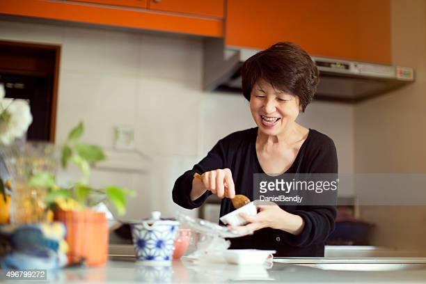Japanese woman preparing meal
