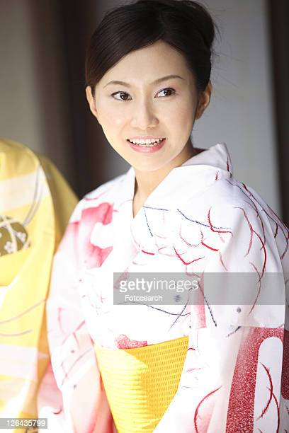 Japanese woman putting on a yukata