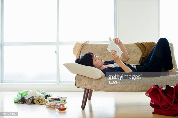 Japanese woman reading in her apartment