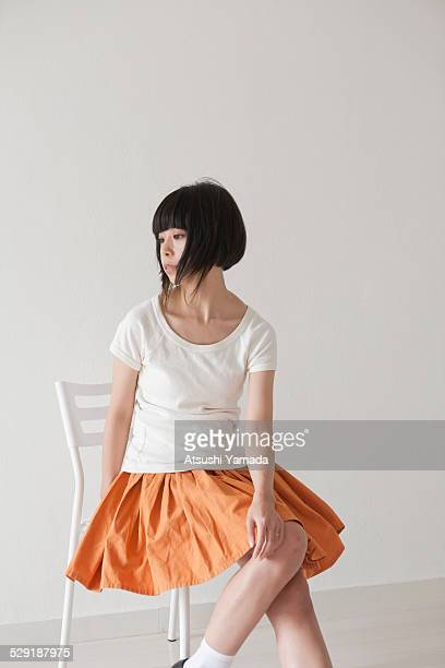 Japanese woman sitting on chair