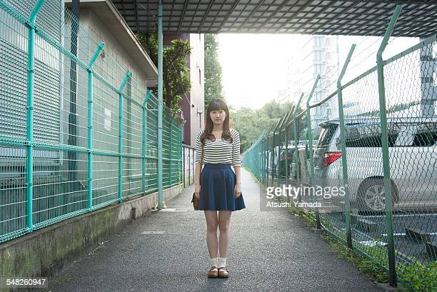 Japanese woman standing on street