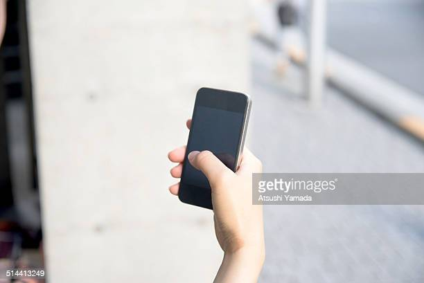 Japanese woman using cell phone,close up