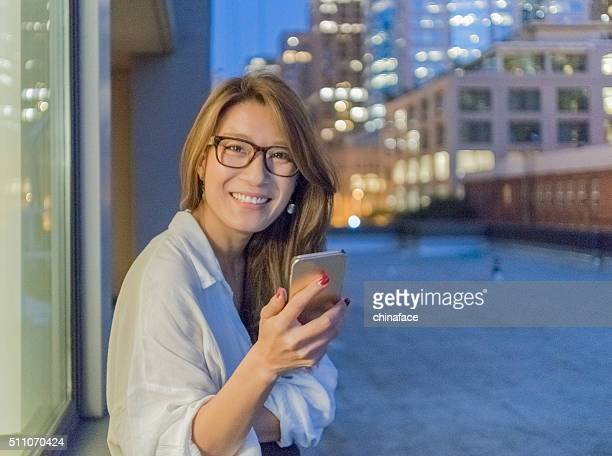 Japanese woman using cellphone at night