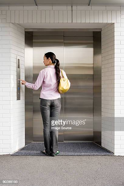 Japanese woman waiting for an elevator