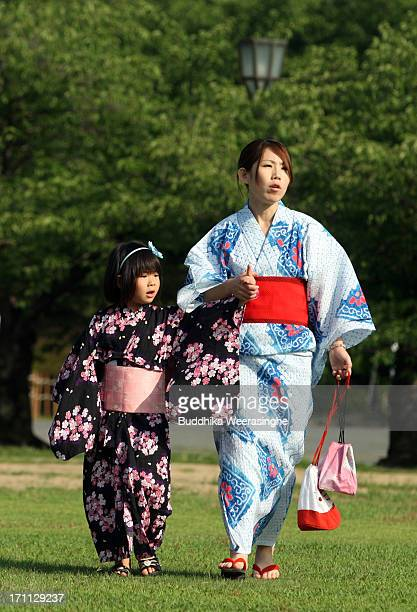 Japanese woman wear 'Yukata' summer kimono walk with her child during the annual Himeji Yukata Festival on June 222013 in Himeji Japan The Himeji...