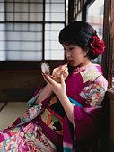 Japanese woman wearing kimono, wearing lipstick