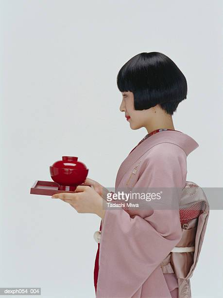 Japanese woman wearing kinomo with serving tray and bowl