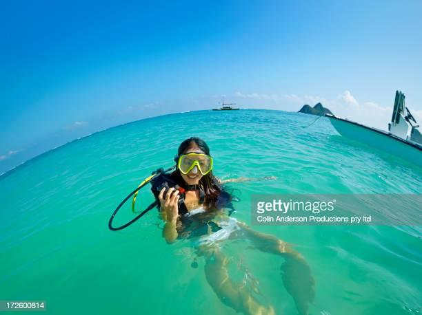 Japanese woman wearing scuba gear in ocean