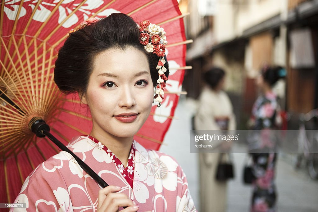 Japanese Woman With A Red Umbrella In Kyoto Japan Stock