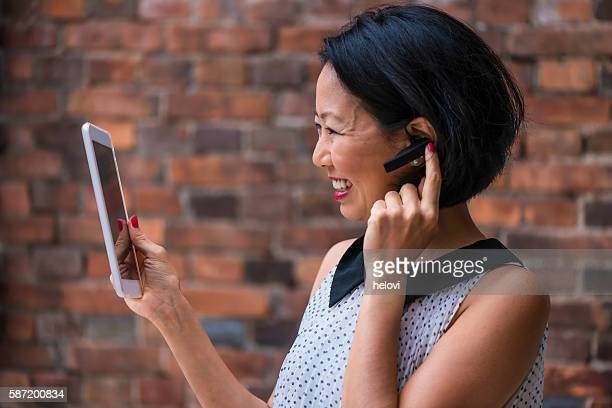 Japanese woman with bluetooth talking
