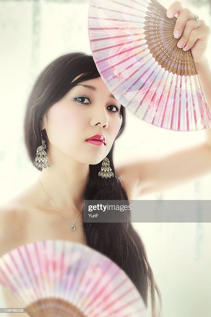 Japanese woman with folding fans. : Stock Photo