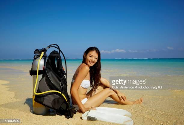 Japanese woman with scuba gear on beach