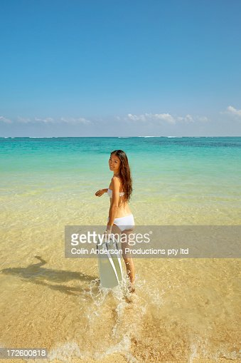 Japanese woman with snorkel fins on beach : Stock Photo
