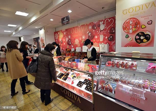 Japanese women buy chocolates at Tokyo's Takashimaya department store on February 13 one day before Valentine's Day Japanese women thronged...