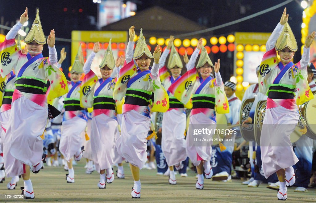 Japanese women dressed in traditional costume perform Awa-Odori dance during the annual 'Awa Odori' or Awa Dance Festival on August 12, 2013 in Tokushima, Japan. This festival is held from 12 to 15 of August as a part of the Obon festival, attracting over 1.3 million tourists.