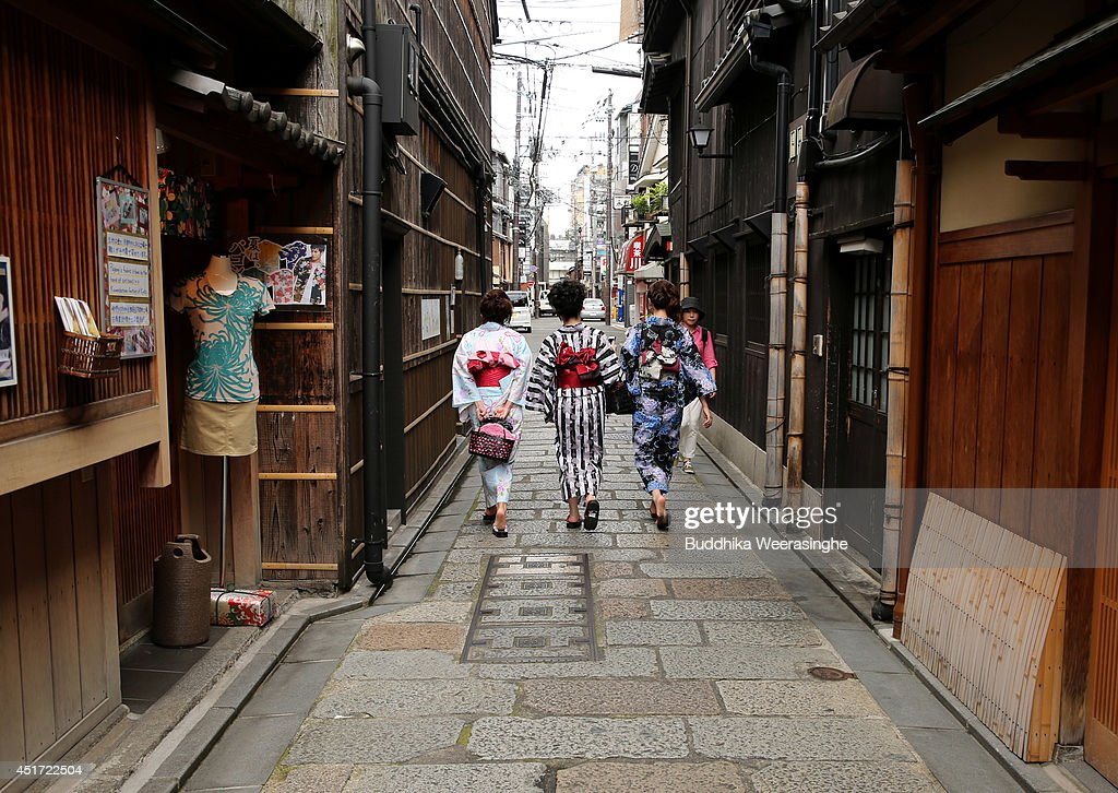 Japanese women dressed in Yuakata, summer kimono walk on July 5, 2014 in Kyoto, Japan. Kyoto has been named the world's best city in the U.S. magazine Travel + Leisure for 2014, according to its website. The former capital of Japan is known for old temples and shrines.