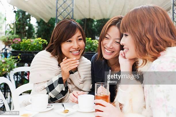 Japanese Women Laughing and Joking in Tokyo Street Cafe