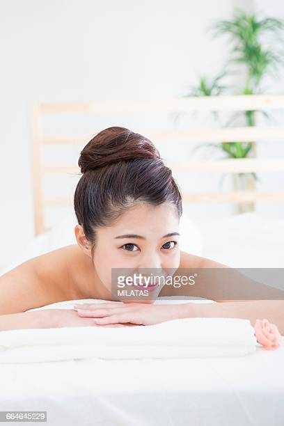 Japanese women lie down in bed for esthetic treatment