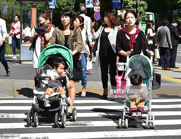 Japanese women push baby carts in Tokyo on October 2 2015 Spending among Japanese households rebounded in August offering a glimmer of hope after a...